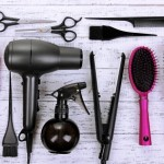 24551892 - hairdressing tools on white wooden table close-up