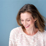 37864511 - close up portrait of a beautiful mid adult woman laughing with sweater