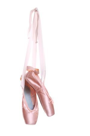 7051099 - hanging pink ballet shoes isolated on a white background